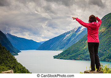 Woman tourist in norwegian mountains fjords - Travel...