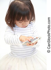 Japanese girl using a smart phone (2 years old)