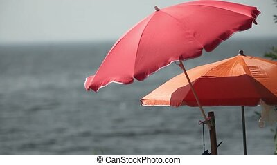 umbrella and motorboat on beach shallow depth of field zoom...