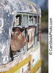 Rusted out old school bus abandoned in the countryside -...