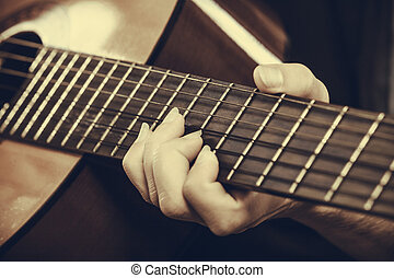 Closeup of man playing acoustic guitar - Music, sound,...