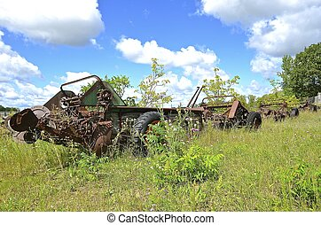 Old rusty manure spreaders - A row of old rusty manure...