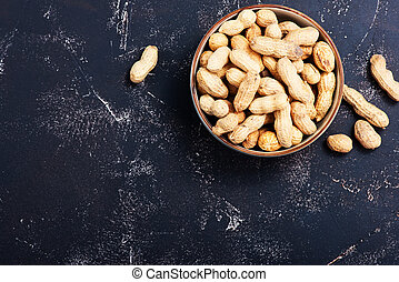peanuts in bowl and on a table