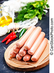 sausages on board and on a table
