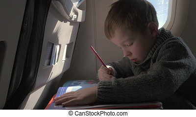 Close up view of small boy learning to writing with pencil -...