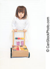 Japanese girl pushing a cart (2 years old)