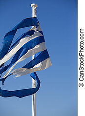 A broken greek flag with a clear blue sky - A broken greek...