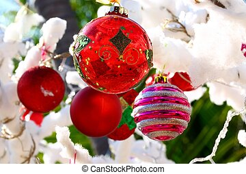 christmas bulbs on cotton covered tree