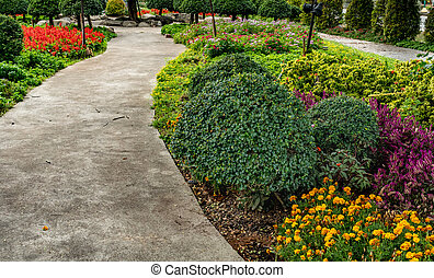 Concrete Pathway in park - Concrete pathway with green...