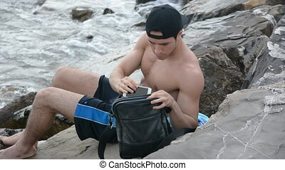Young Man Using Cell Phone - Shirtless Young Handsome Man...