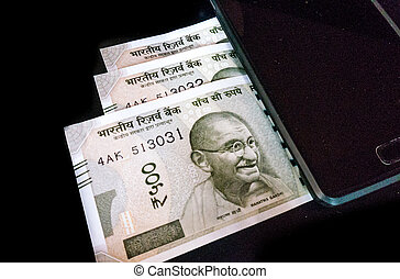 New Indian currency with a mobile device - With the ban of...