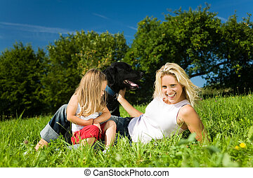 Mother with child and dog