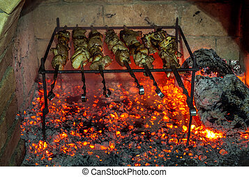 Burning fireplace and barbecue pork.