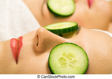 Cucumber beauty girls - Girls in a beauty treatment with...