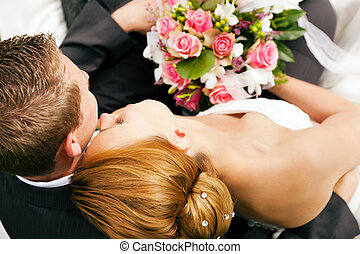 Wedding - tenderness - wedding couple hugging and kissing,...