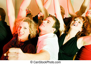 People dancing in a club - Crowd of people dancing in a...
