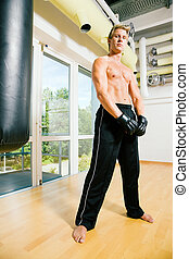 Martial Arts Training - Boxer standing right beside the...