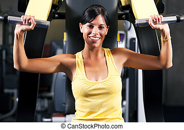 Fitness workout in gym - Very fit and beautiful young woman...