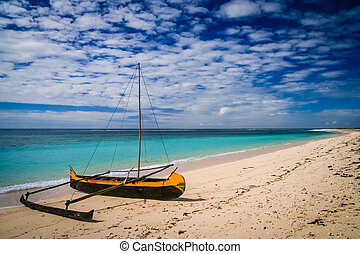 Traditional pirogue on the shore - Small traditional pirogue...