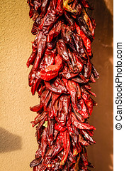 Red Chilli Ristra outside a house in Santa Fe NM - Red...