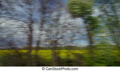 View from riding train window of coutryside landscape...