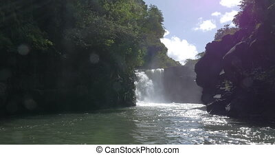 Waterfall and black volcanic rocks in Mauritius - View from...