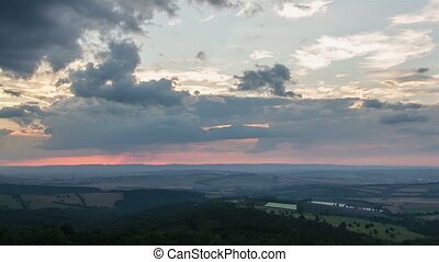 Colorful sunset sky over countryside time lapse