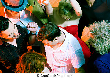 People dancing in a club