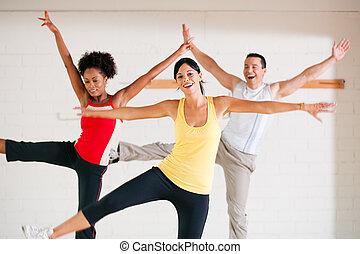 Aerobics training in gym - Group of three people in colorful...