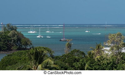 Timelapse of sailing yachts neat the coastline, Mauritius -...