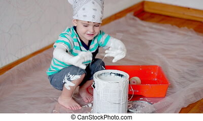 little boy kid painting the white wall at home - Little...