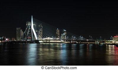 Timelapse night shot of traffic on the Erasmus Bridge,...