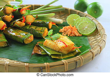 Vietnamese steamed rice pancake with shrimp on tray with...