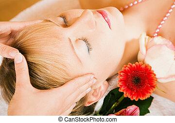 Head massage - Beautiful woman enjoying a head massage