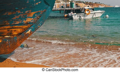 Beach in Egypt. Resort Red Sea Coast. Coast guard boat near...