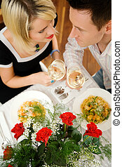 Couple with pasta and wine - Young couple romantic dinner:...