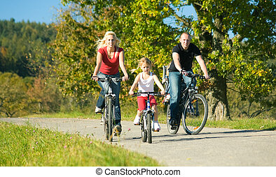 Family on bikes - family with children having a weekend...