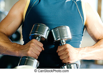 Guy with dumbbells