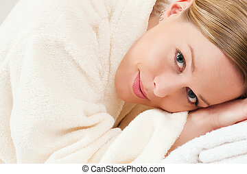 Woman with bath robe in spa