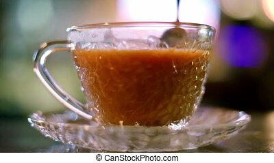 Stirring hot milk tea in cafe - Stirring hot milk tea in a...