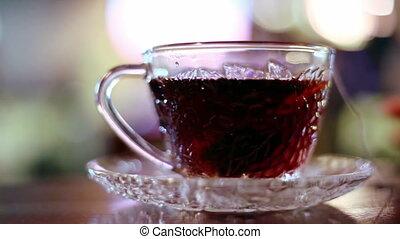 Black tea in a bag brewed in a glass cup - Black tea in a...