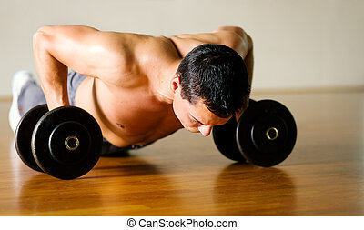 Workout - pushups - Strong, handsome man doing push-ups on...