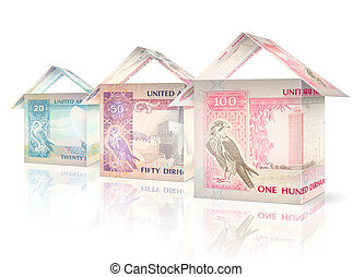 Money Houses - Money bills folded like houses standing next...