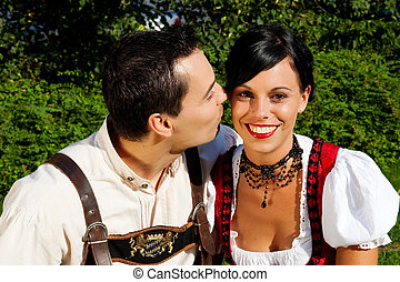 Couple in traditional Bavarian dress in summer - Couple -...