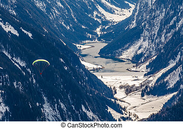 Paragliding in the mountains - Photo of paraglider in the...