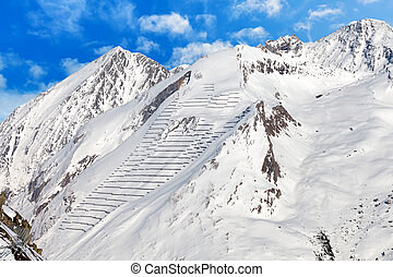 Avalanche protection barriers on mountainside - Photo of...