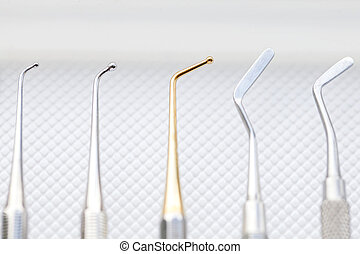 Dental cavity filling instruments
