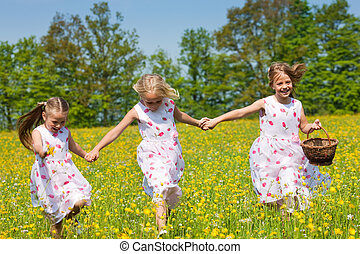 Children on Easter egg hunt with baskets - Children on an...