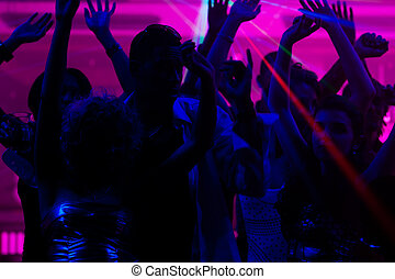 People dancing in club with laser - Group of friends - men...