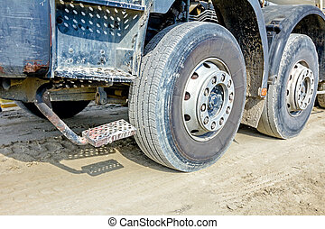 Steps on the side of a truck and undercarriage wheel - Low...